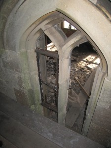 View through a damaged window showing dilapidation beyond